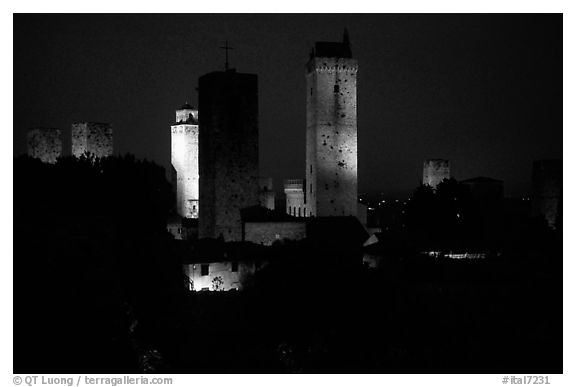 Medieval towers seen from the Rocca at night. San Gimignano, Tuscany, Italy (black and white)