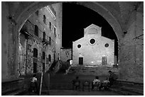 Duomo framed by an arch at night. San Gimignano, Tuscany, Italy (black and white)