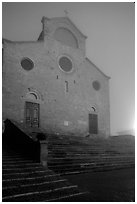 Duomo at dawn in the fog. San Gimignano, Tuscany, Italy ( black and white)