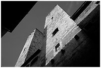 Medieval tower seen from the street, early morning. San Gimignano, Tuscany, Italy ( black and white)