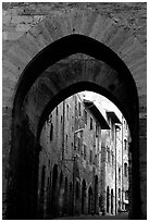 Arch and street. San Gimignano, Tuscany, Italy ( black and white)