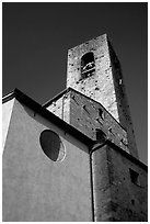 Massive shapes of the Duomo. San Gimignano, Tuscany, Italy (black and white)