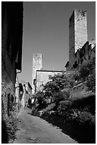 Street dominated by medieval towers. San Gimignano, Tuscany, Italy (black and white)