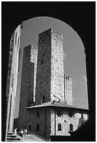 Medieval Towers framed by an arch. San Gimignano, Tuscany, Italy (black and white)