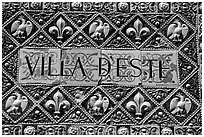Ceramic sign at the entrance of Villa d'Este. Tivoli, Lazio, Italy ( black and white)