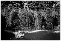 Elaborate fountain in the gardens of Villa d'Este. Tivoli, Lazio, Italy ( black and white)
