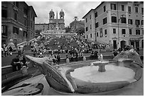 Fontana della Barcaccia at the foot of the Spanish Steps. Rome, Lazio, Italy (black and white)