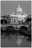 Bridge and Basilic Saint Peter reflected in Tiber River, sunrise. Vatican City (black and white)