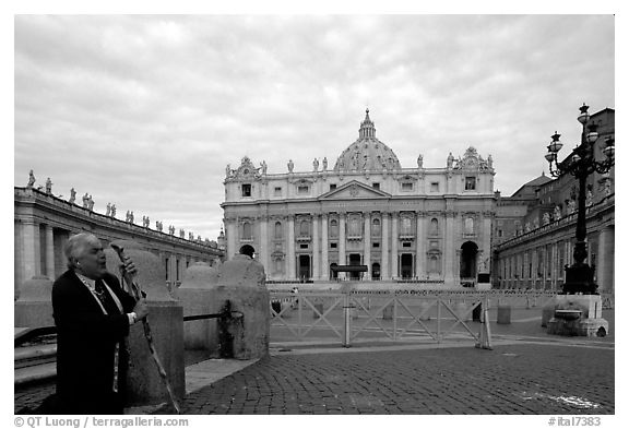Pilgrim prays in front of the Basilic Saint Peter. Vatican City (black and white)