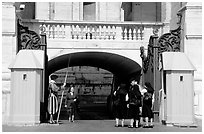 Nuns move past checkpoint manned by Swiss guards. Vatican City (black and white)