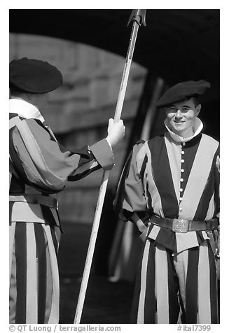 Papal Swiss guards in colorful traditional uniform. Vatican City (black and white)
