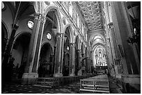 Church interior looking down the nave to the apse. Naples, Campania, Italy (black and white)