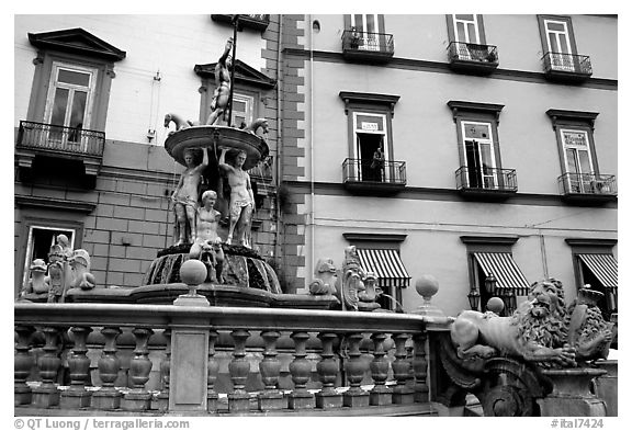 Fountain with man at balcony in background. Naples, Campania, Italy (black and white)