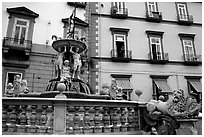 Fountain with man at balcony in background. Naples, Campania, Italy ( black and white)