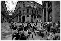 Women enjoy gelato inside the Galleria Umberto I. Naples, Campania, Italy (black and white)
