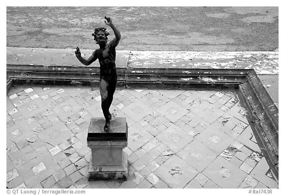 Statue in Casa del Fauno (Villa of the Faune). Pompeii, Campania, Italy (black and white)