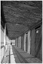 Row of changing cabins, Paestum. Campania, Italy (black and white)