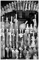Bottles of Lemoncelo, the local lemon-based liquor, Amalfi. Amalfi Coast, Campania, Italy (black and white)