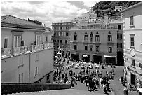 Plazza with wedding party seen from the stairs of Duomo Sant'Andrea, Amalfi. Amalfi Coast, Campania, Italy (black and white)