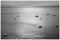 Small boats at sunset in the Gulf of Salerno, Positano. Amalfi Coast, Campania, Italy (black and white)
