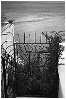 Forged metal entrance to a garden overlooking the sea, Positano. Amalfi Coast, Campania, Italy (black and white)