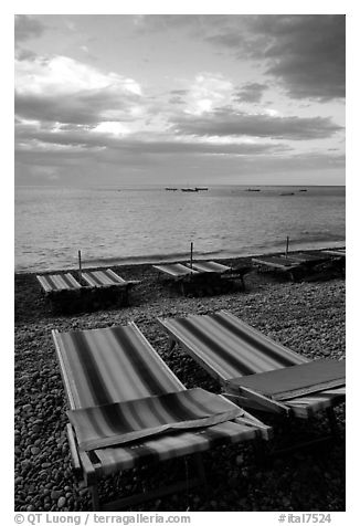 Beach chairs on Spiaggia del Fornillo at sunset, Positano. Amalfi Coast, Campania, Italy (black and white)