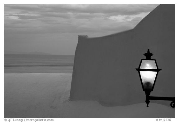 Lamp, White walls, pastel colors of sunset, Positano. Amalfi Coast, Campania, Italy (black and white)