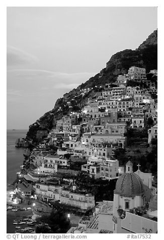 Positano at dawn, with the ceramic dome of Chiesa di Santa Maria Assunta in the foreground. Amalfi Coast, Campania, Italy (black and white)
