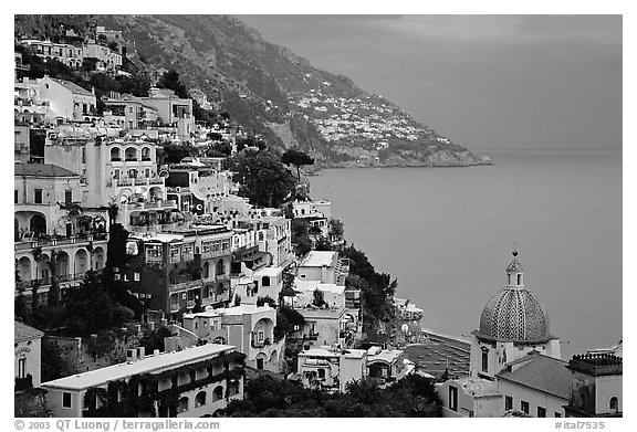 Chiesa di Santa Maria Assunta and houses on steep hills at dusk, Positano. Amalfi Coast, Campania, Italy (black and white)