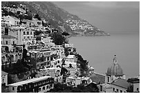 Chiesa di Santa Maria Assunta and houses on steep hills at dusk, Positano. Amalfi Coast, Campania, Italy ( black and white)