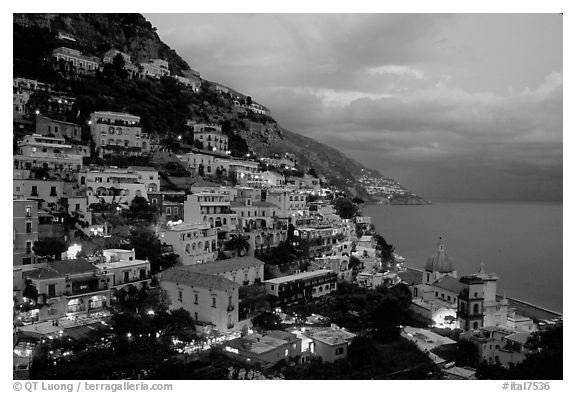 Positano lights coming up at dusk. Amalfi Coast, Campania, Italy