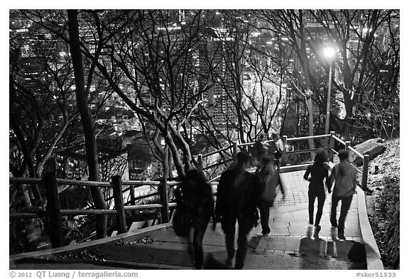 People on Namsan stairs by night. Seoul, South Korea (black and white)