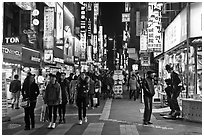 Shoppers on pedestrian street by night. Seoul, South Korea ( black and white)