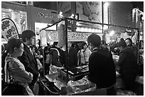Busy food stall by night. Seoul, South Korea ( black and white)