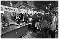 People lining up for street food. Seoul, South Korea (black and white)