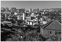 Hanok houses overlooking modern skyline. Seoul, South Korea ( black and white)