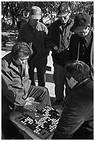 Elderly men play game of baduk (go). Seoul, South Korea ( black and white)