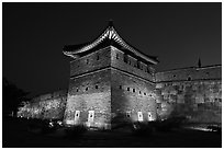Suwon Hwaseong Fortress tower at night. South Korea ( black and white)