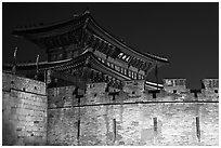 Wall and Janganmun gate at night, Suwon Hwaseong Fortress. South Korea ( black and white)