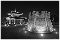 Crossbow tower and command post at night,  city lights, Suwon. South Korea (black and white)