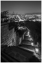 Path, wall, and city lights, Suwon Hwaseong Fortress. South Korea ( black and white)