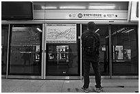 Seoul Subway with platform screen doors. Seoul, South Korea (black and white)
