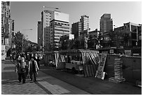 Street lined up with food stalls. Seoul, South Korea (black and white)