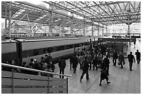 Passengers boarding high speed KTX train. Seoul, South Korea (black and white)