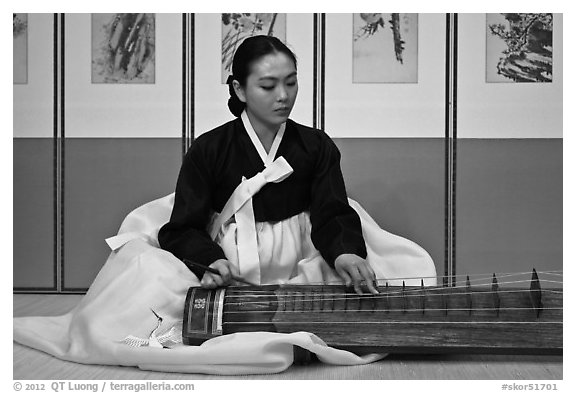 Woman playing traditional instrument. South Korea (black and white)