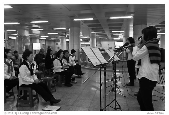 Music concert in subway. Daegu, South Korea (black and white)