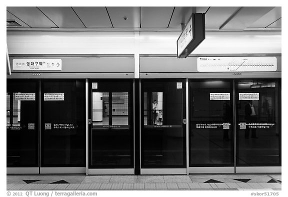 Platform screen doors in subway. Daegu, South Korea (black and white)