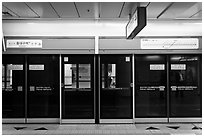 Platform screen doors in subway. Daegu, South Korea ( black and white)