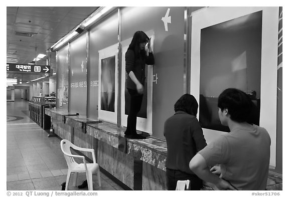 Photography exhibit being installed in subway. Daegu, South Korea
