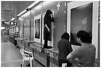 Photography exhibit being installed in subway. Daegu, South Korea (black and white)